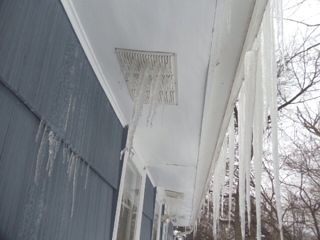 Ice_damage_to_soffit_and_siding.jpg