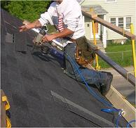 Roofer working with guard rails