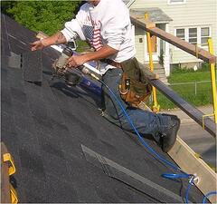 roofer with fall protection