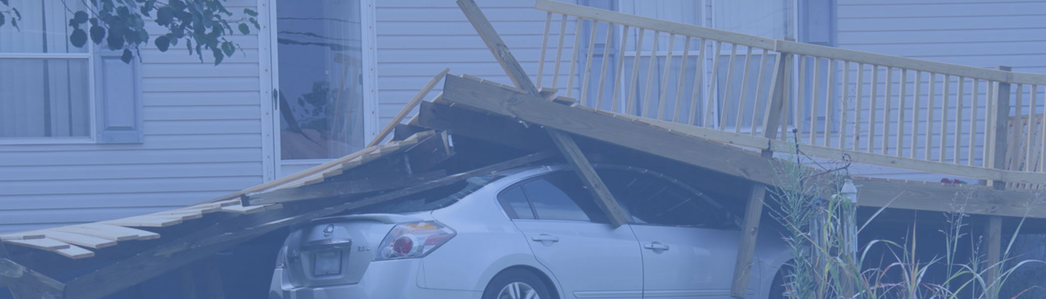 car crash into house